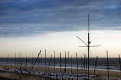 Lots of sailing yachts on seashore at sunset Royalty Free Stock Photography