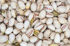 A lots of salty pistachios. Royalty Free Stock Image