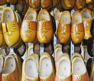 Lots of shoes. Wooden shoes on a rack Royalty Free Stock Photography