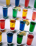 Lots Of Shots. Shot glasses lined up full of different colors of liquid Royalty Free Stock Image
