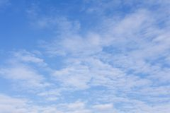 Lots of small white clouds on blue sky . stock photography