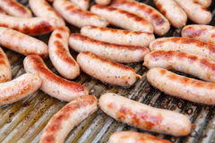 Lots of small white grilled sausages Royalty Free Stock Photos