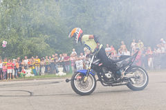 Lots of smoke on Moto show in Verkhovazhye, Vologda region, Russia. Foma Kalinin young stunt Royalty Free Stock Photos