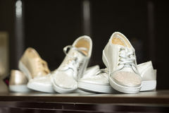 Lots of sneaker shoes on sale Stock Images