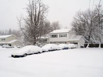 Lots of Snow. This is a shot of a snowed in house with 4 cars in the driveway Royalty Free Stock Photos