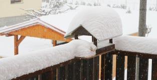 Lots of snow on the balcony. Falling snow on a snowy balcony Royalty Free Stock Photos