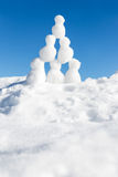 A lots of snow figures building a pyramid in the snow Stock Photos