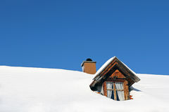 Lots of snow on a house roof. An old farmhouse with lots of snow on the roof Stock Photography