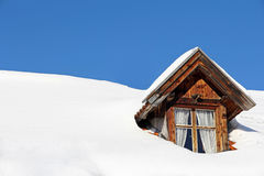 Lots of snow on a house roof. An old farmhouse with lots of snow on the roof Stock Photo