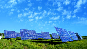 Lots of Solar Panels, with beautiful Clouds Stock Photo