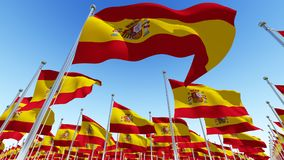 Lots of Spain flags fluttering in the wind Royalty Free Stock Photo
