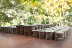 Lots stack coins on wooden desk background texture, Money for business planning investment. And saving concept royalty free stock images