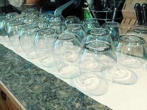 Stemless Wine Glasses. Lots of stemless wine glasses on a counter stock images
