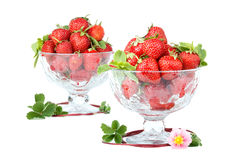 Lots of strawberries in two glass bowls over white. Royalty Free Stock Photography