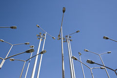Lots of streetlamps together in perspective. More than fifteen streetlamps together in perspective Royalty Free Stock Photography