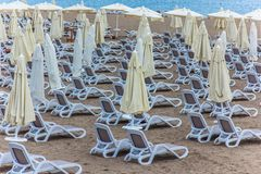 Lots of sun loungers on the beach royalty free stock photo