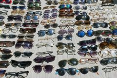 Lots of sunglasses and shades in a flea market in a sunny day in Istanbul stock photos