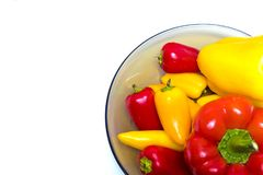 Lots of sweet peppers in bowl. Good quality photo of fresh peppers served on some snow white surface in a bowl made of smoked transparent glass. There`re lots of Stock Image