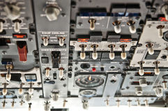 Lots of switches - modern jet airliner cockpit Royalty Free Stock Image