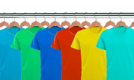 Lots of T-shirts on hangers isolated on white Stock Photos