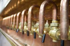 Lots of taps in brewery Stock Photography
