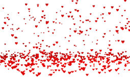 Lots of Tiny Red Hearts with a Defocus Effect. With a white background Royalty Free Stock Photography