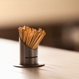 Lots of toothpics on wooden table of restaurant Royalty Free Stock Photos