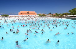 Lots of tourists enjoying artificial wave in Siam Park on Tenerife Stock Images