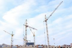 Lots of tower Construction site with cranes and building with blue sky background royalty free stock photos