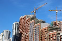 Lots of tower Construction site with cranes and building with blue sky background stock photography