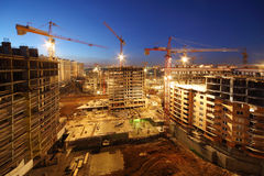 Lots of tower cranes build large residential buildings Royalty Free Stock Photo