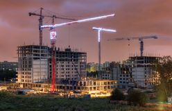 Lots of tower cranes build residential buildings at evening Stock Photography