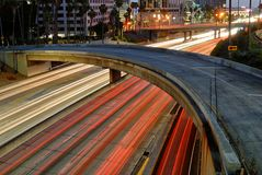 The trails of headlights and tail lights on a freeway in Los Angeles stock photo