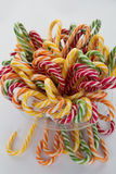 Lots of twisted candies in different nice colors isolated Royalty Free Stock Photos