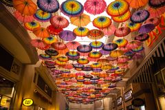 Lots of umbrella coloring the sky on Dubai Mall stock photography