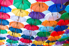 Lots of umbrellas coloring the sky Royalty Free Stock Images