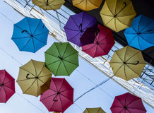 Lots of umbrellas coloring the sky in the city Royalty Free Stock Photos