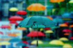 Lots of umbrellas in the rain. The lots of umbrellas in the rain Stock Photo