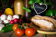 A lots of vegetables and bread on a wooden table Royalty Free Stock Images