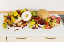 Lots of vegetables, fruits and herbs. Lots of vegetables and fruits on the kitchen table Stock Image