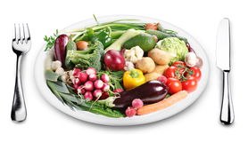 Lots of vegetables on a plate. Stock Photo