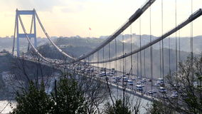 Lots of vehicle passing from Fatih Sultan Mehmet (FSM) Bridge view during rush hours stock footage