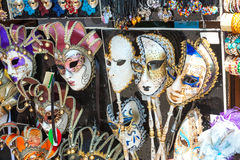 Lots of Venetian masks on display Stock Photos