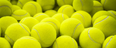 Lots of vibrant tennis balls Stock Photos
