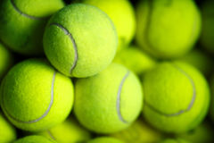 Lots of vibrant tennis yellow balls royalty free stock photography