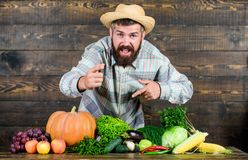 Lots of vitamin. man chef with rich autumn crop. seasonal vitamin food. Useful fruit and vegetable. bearded mature. Farmer. organic and natural food. happy royalty free stock photos