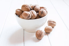 Lots of walnuts on a white background Royalty Free Stock Photo