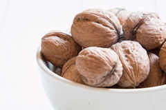 Lots of walnuts on a white background Stock Photo