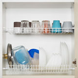 Lots of wet dishes. In the dish draining closet stock photo