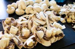 White mushrooms as pizza ingredients Royalty Free Stock Image